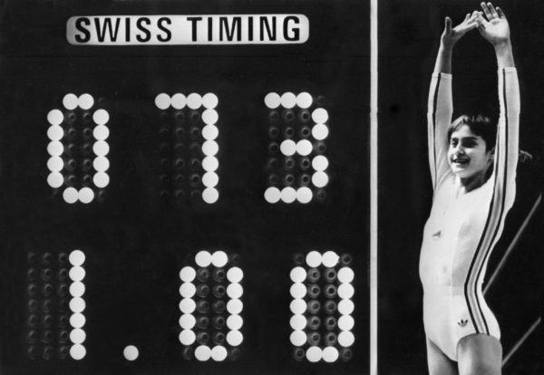 Rumanian champion Nadia Comaneci, aged 14, jubilates when scoreboard shows the perfect score of 10 during Olympic Games 19 July 1976 in Montreal after her acrobatic compulsory at uneven bars. She was awarded with ten points in two exercices and captured 3 gold medals (beam, uneven bars and general competition). Legendary gymnast, during her career Nadia Comaneci captured four Olympic gold medals (1976 : beam, uneven bars and general competition - 1980, beam) and was the first to score 10 in her discipline. / AFP